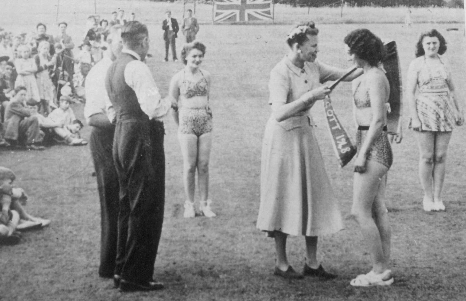 Sash being awarded to 'bathing beauty'