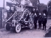 decorated miniature fire engine with firemen